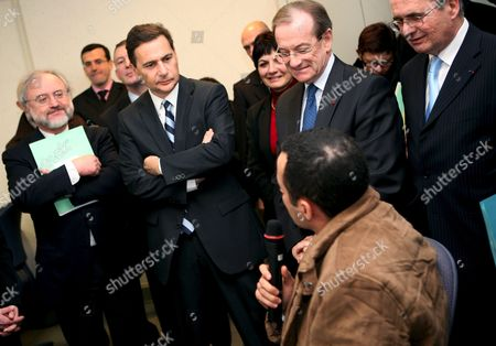 French Immigration Minister Eric Besson (c) and Chief Police Michel Gaudin (r) and General Police Director Jacques Quastanay (l) Listen to a Moroccan Asking For Regularisation at the Police Department in Paris France 05 February 2009 Immigration Minister Eric Besson Visits the Police Department to See the New Policy and Strategy to Fight Against Illegal Immgration and Clandestinity L