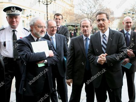French Immigration Minister Eric Besson (r) and Chief Police Michel Gaudin (c) General Police Director Jacques Quastanay (2-l) Arrive to the Police Department in Paris France 05 February 2009 Besson Visited the Police Department to See the New Policy and Strategy to Fight Against Illegal Immgration and Clandestinity L