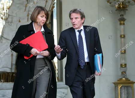 French Foreign Minister Bernard Kouchner (r) Chats with Culture Minister Christine Albanel (l) As They Leave After Taking Part in the French Council Ministers at the Elysee Palace in Paris France 25 February 2009