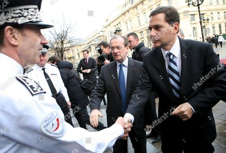 French Immigration Minister Eric Besson (r) and Chief Police Michel Gaudin (c) Greets a Police Officer As They Arrive to the Police Department in Paris France 05 February 2009 Immigration Minister Eric Besson Visits the Police Department to See the New Policy and Strategy to Fight Against Illegal Immgration and Clandestinity L