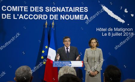 Stock Image of French Prime Minister Francois Fillon (l) is Accompanied by Junior Minister Ofr Overseas Marie-luce Penchard As He Gives an Opening Speech During His Press Conference About the 9th Meeting of the Noumea Accords' Signatories in Paris France 08 July 2011 the Noumea Accords Which Were Signed in 1998 Are Committed to Transferring Political Power to New Caledonia a Special Collectivity of France Until the Territory Decides by Referendum to Become Independent Or Remain French Fillon Presided Over the Meeting in Which It was Decided to Continue Monitoring the Political Situation and the Future of the Pacific Territory France Paris