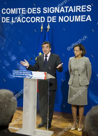 Stock Photo of French Prime Minister Francois Fillon (l) is Accompanied by Junior Minister Ofr Overseas Marie-luce Penchard As He Gives an Opening Speech During a Press Conference About the 9th Meeting of the Noumea Accords' Signatories in Paris France 08 July 2011 the Noumea Accords Which Were Signed in 1998 Are Committed to Transferring Political Power to New Caledonia a Special Collectivity of France Until the Territory Decides by Referendum to Become Independent Or Remain French Fillon Presided Over the Meeting in Which It was Decided to Continue Monitoring the Political Situation and the Future of the Pacific Territory France Paris