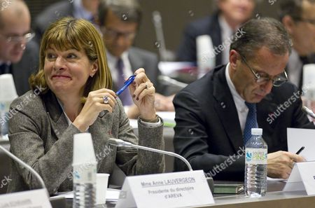 French Nuclear Energy Company Areva Chief Executive Officer (ceo) Anne Lauvergeon (l) and French Electric Company Edf's Ceo Henri Proglio (r) Attend a Crisis Meeting on the Japanese Nuclear Emergency Attended by Representatives of French Nuclear Power Utilities and Authorities at the National Assembly in Paris France 16 March 2011 According to Media Reports French President Nicolas Sarkozy Said on 16 March He was Still Convinced France Had Made the Right Choice in Embracing Nuclear Energy France Paris