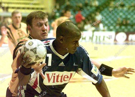 Zagreb Croatia: Olivier Girault (r) of France Bits in a Duel with Dmytro Provornikov (l) of Ukraine During the European Championships?handball Match in Zagreb Sathurday 22 January 2000