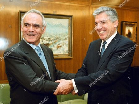 Athens Greece: Greek New Defence Minister Yannos Papantoniou (r) Shakes Hands with Ex-defence Minister Akis Tsochatzopoulos (l) During the Ceremony For the Delivery of the Duties From the New Minister in Athens on Wednesday 24 October 2001 Greek Prime Minister Costas Simitis Reshuffled His Government on Tuesday in a Bid to Push Forward Reforms Appointing 20 Newcomers to His Cabinet and Naming Close Aides to the Economics Defense and Development Ministries
