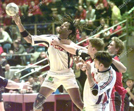 Zagreb Croatia: Olivier Girault (l) of France Comes Under Pressure From Norways Tormod Moldestad (far Right) and an Unidentified Team-mate During Their Match at the European Handball Championship in Zagreb Friday 21 January 2000 Electronic Image)