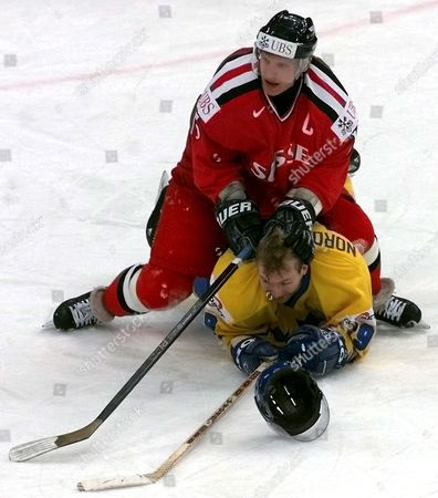 St Petersburg Russian Federation : Swiss Forward Reto Von Arx (up) Attacks Swedish Peter Nordstrom (down) During Their Qualifying Match at the Ice Hockey World Championship in St Petersburg Saturday 06 May 2000 the Score After the Game is 1-1 (electronic Image)