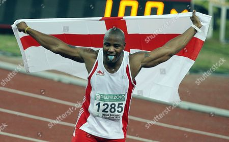 England's Mark Anthony Lewis-francis Celebrates His Second Place in the Men's 100m Final of the Track and Field Competition of the Commonwealth Games in New Delhi India on 7 October 2010 Jamaica's Lerone Clarke Powered to the Men's 100 Metres Title at the Commonwealth Games Crossing the Line in 10 12 Seconds Followed by England's Mark Anthony Lewis- India New Delhi
