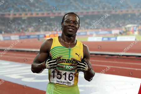 Jamaican Lerone Clarke Celebrates His Win in the Men's 100m Final of the Track and Field Competition of the Commonwealth Games in New Delhi on 7 October 2010 Jamaica's Lerone Clarke Powered to the Men's 100 Metres Title at the Commonwealth Games Crossing the Line in 10 12 Seconds Followed by England's Mark Anthony Lewis India New Delhi