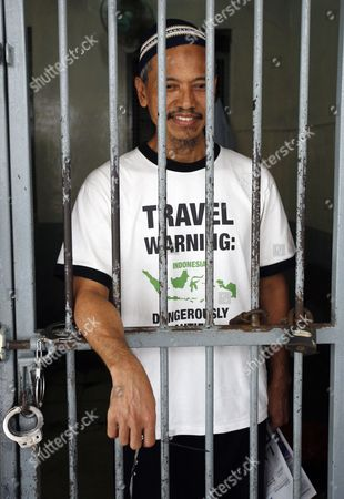 Indonesian Terror Suspect and Father in Law of Alleged Terrorist Noordin M Top Baharudin Alias Baridin Stands Behind Bars Shortly Before His Trial in Jakarta Indonesia 28 September 2010 Prosecutors Demanded Six Year in Jail For Baharudin For Violating Indonesia's Anti-terror Law by Concealing Information and Harboring Terrorists Linked with the July 17 Attacks at the J W Marriott and Ritz Carlton Hotels Indonesia Jakarta