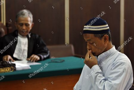 Indonesian Terror Suspect and Father in Law of Alleged Terrorist Noordin M Top Baharudin Alias Baridin (r) is Pictured During His Trial in Jakarta Indonesia 28 September 2010 Prosecutors Demanded Six Year in Jail For Baharudin For Violating Indonesia's Anti-terror Law by Concealing Information and Harboring Terrorists Linked with the July 17 Attacks at the J W Marriott and Ritz Carlton Hotels Indonesia Jakarta