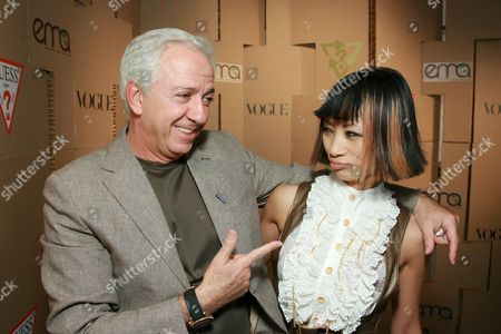 Stock Photo of Paul Marciano and Bai Ling