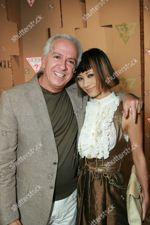 Paul Marciano and Bai Ling