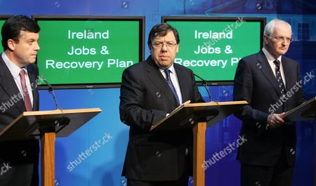 Irish Prime Minister Brian Cowen is Joined by the Irish Finance Minister Brian Lenihan (l) and Environment Minister John Gormley (r) As He Addresses the World's Media During a Major News Conference at Goverment Buildings Dublin 24 November 2010 the Irish Government Has Unveiled a Range of Tough Austerity Measures Designed to Help Solve the Country's Debt Crisis Among the Spending Cuts and Tax Rises Are a Reduction in the Minimum Wage a New Property Tax and Thousands of Public Sector Job Cuts the Four-year Plan is Designed to Save the State 15bn Euros the Government is Also Negotiating a Bail-out Package with the Eu and Imf Expected to Be Worth About 85bn Euros Ireland Dublin