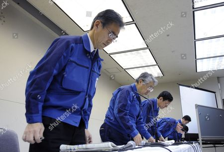Tokyo Electric Power Co (tepco) Executive Vice-president Takashi Fujimoto (2-l) and Company Officials Bow at the End of a News Conference at the Company Headquarters in Tokyo Japan 05 April 2011 Shares of Tepco Continued to Drop After the Company Started to Dump Radioactive Water Into the Sea From Its Quake-hit Fukushima Daiichi Nuclear Plant Tepco Stock Fell to Mark Its Lowest Price in 59 Years After Concerns Over Compensation Payments the Firm Will Face For Damages Japan Tokyo