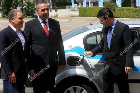 Moshe Kaplinsky (c) Ceo and Shai Agassi (r) Ceo Next to the New Model 'Electric Car Future' During a Test Drive and Press Conference in Tel Aviv Israel 11 May 2008 in January 2008 the Israeli Government Announced Its Support of an Ambitious Plan to Install the World's First Electric Car Network in Israel by 2011 the Initiative is Aimed at Addressing Global Dependence On Foreign Oil From Undemocratic Regimes and Mitigating the Health and Environmental Damages Caused by Emissions From Gas-burning Vehicles