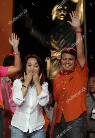 Presidential Candidate Senator Manny Villar (r) and Vice Presidential Candidate Senator Loren Legarda (l) Hold Hands During a Proclamation Rally in Tondo Manila Philippines on 29 November 2009 Villar was the Only Presidential Aspirant who Experienced to Live in Poverty Philippines Manila