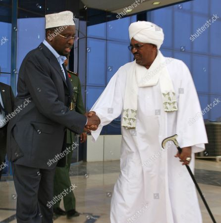 Sudanese President Omar Al-bashir (r) Meets with Current President of Somalia and Former Commander in Chief of the Islamic Courts Union (icu) Sheikh Sharif Ahmed (l) at Khartoum Airport in Khartoum Sudan 01 August 2011 Sheikh Sharif Ahmed is in Sudan on a Working Visit As the International Committee of the Red Cross on 01 August Trucked in the First 'Large-scale' Food Delivery Into Drought-stricken Areas of Somalia Under the Control of the Islamist Al-shabaab Militia Al-shabaab Which Has Links to Al-qaeda Has Banned Most Aid Groups From Working in the Areas It Controls Sudan Khartoum