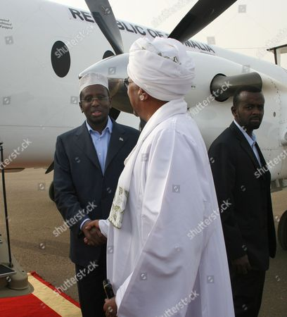 Sudanese President Omar Al-bashir (c) Meets with Current President of Somalia and Former Commander in Chief of the Islamic Courts Union (icu) Sheikh Sharif Ahmed (l) at Khartoum Airport in Khartoum Sudan 01 August 2011 Sheikh Sharif Ahmed is in Sudan on a Working Visit As the International Committee of the Red Cross on 01 August Trucked in the First 'Large-scale' Food Delivery Into Drought-stricken Areas of Somalia Under the Control of the Islamist Al-shabaab Militia Al-shabaab Which Has Links to Al-qaeda Has Banned Most Aid Groups From Working in the Areas It Controls Sudan Khartoum