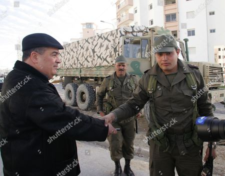Tunisian Dissident Journalist Taoufik Ben Brik (l) Greets a Soldier in Tunis Tunisia 21 January 2011 According to Local Media Reports Ben Brik Has Announced He Would Be Candidate For the Next Presidential Elections in Tunisia Tunisians Began a Three-day National Mourning Period on 21 January in Memory of the Victims of the Latest Events Which Led to the Departure of Former President Zine El-abedine Ben Ali and the Formation of an Interim Government Tunisia Tunis