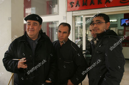 Tunisian Dissident Journalist Taoufik Ben Brik (l) is Seen with His Friends in Tunis Tunisia 21 January 2011 According to Local Media Reports Ben Brik Has Announced He Would Be Candidate For the Next Presidential Elections in Tunisia Tunisians Began a Three-day National Mourning Period on 21 January in Memory of the Victims of the Latest Events Which Led to the Departure of Former President Zine El-abedine Ben Ali and the Formation of an Interim Government Tunisia Tunis