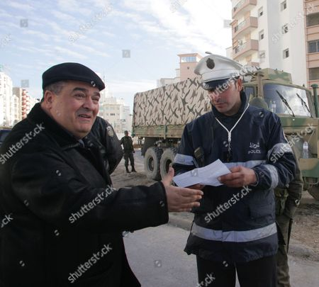 Stock Picture of Tunisian Dissident Journalist Taoufik Ben Brik (l) Speaks to a Policeman in Tunis Tunisia 21 January 2011 According to Local Media Reports Ben Brik Has Announced He Would Be Candidate For the Next Presidential Elections in Tunisia Tunisians Began a Three-day National Mourning Period on 21 January in Memory of the Victims of the Latest Events Which Led to the Departure of Former President Zine El-abedine Ben Ali and the Formation of an Interim Government Tunisia Tunis