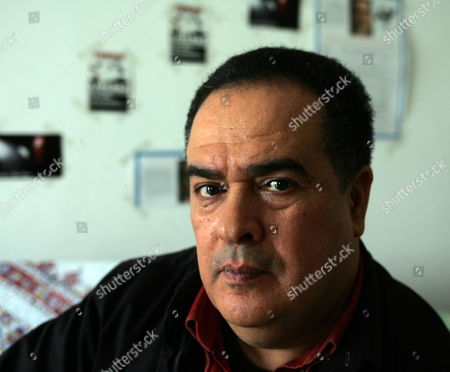 Tunisian Journalist Taoufik Ben Brik Poses For a Photograph Upon His Arrival at His Home in Tunis Tunisia 27 April 2010 Ben Brik was Freed 27 April After Spending Six Months in Jail For Assault Charges Which According to the Media Watchdog Reporter Sans Frontieres and His Lawyer Were Trumped Up the Journalist Has Been Known For His Criticism of Tunisian President Zine El Abidine Ben Ali Tunisia Tunis
