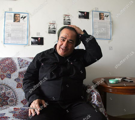 Tunisian Journalist Taoufik Ben Brik is Seen Upon His Arrival at His Home in Tunis Tunisia 27 April 2010 Ben Brik was Freed 27 April After Spending Six Months in Jail For Assault Charges Which According to the Media Watchdog Reporters Without Borders and His Lawyer Were Trumped Up the Journalist Has Been Known For His Criticism of Tunisian President Zine El Abidine Ben Ali Tunisia Tunis