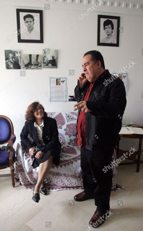 Tunisian Journalist Taoufik Ben Brik (r) Speaks on the Phone As Hi Wife Azza (l) Looks on Upon His Arrival at Home in Tunis Tunisia 27 April 2010 Ben Brik was Freed 27 April After Spending Six Months in Jail For Assault Charges Which According to the Media Watchdog Reporter Sans Frontieres and His Lawyer Were Trumped Up the Journalist Has Been Known For His Criticism of Tunisian President Zine El Abidine Ben Ali Tunisia Tunis