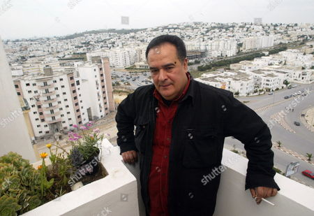 Tunisian Journalist Taoufik Ben Brik Poses For a Photograph Upon His Arrival at His Home in Tunis Tunisia 27 April 2010 Ben Brik was Freed 27 April After Spending Six Months in Jail For Assault Charges Which According to the Media Watchdog Reporters Without Borders and His Lawyer Were Trumped Up the Journalist Has Been Known For His Criticism of Tunisian President Zine El Abidine Ben Ali Tunisia Tunis
