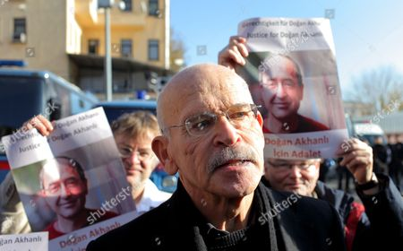 German Investigative Journalist and Author Guenter Wallraff Speaks to Reporters While Supporters Hold Pictures of Turkish-born German Publisher Dogan Akhanli Prior to a Trial at Besiktas Court in Istanbul Turkey on 08 December 2010 Dogan Akhanli who was Arrested in August 2010 During a Visit to Turkey is on Trial on Accusations of Armed Robbery of an Exchange Office in 1989 Turkey Istanbul