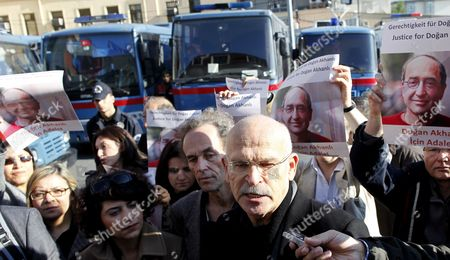 German Investigative Journalist and Author Guenter Wallraff (c Front) Speaks to Reporters While Supporters Hold Pictures of Turkish-born German Publisher Dogan Akhanli Prior to a Trial at Besiktas Court in Istanbul Turkey on 08 December 2010 Dogan Akhanli who was Arrested in August 2010 During a Visit to Turkey is on Trial on Accusations of Armed Robbery of an Exchange Office in 1989 Turkey Istanbul