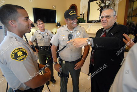 Joseph Arpaio Right Sheriff of Maricopa County in Arizona Talks with San Diego County Sheriff's Officers Before Giving a Presentation For a Meeting of the Conservative Order of Good Government in San Diego California Usa on 10 August 2010 Arpaio Has Drawn Much Attention For His Hard Line Law Enforcement Style and His Support of Local Enforcement of Federal Immigration Laws About 120 Protestors Turned out Against Arpaio United States San Diego