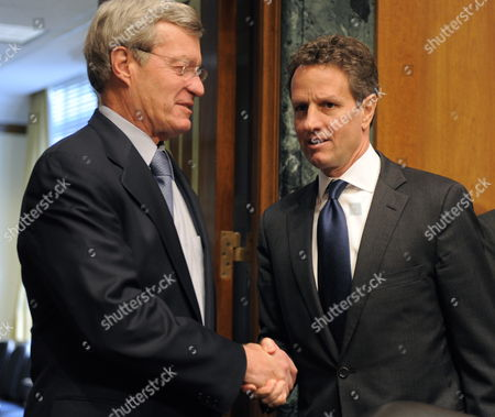 U S Treasury Secretary Timothy F Geithner (r) Shakes Hands with Chairman Max Baucus (democrat / Montana) Prior to Appearing Before the Senate Finance Committee on Capitol Hill in Washington D C 04 May 2010 the Panel was Hearing Testimony on President Barack Obama's Proposed Fee on Financial Institutions Such As Those who Had to Be Rescued During the Troubled Asset Relief Program (tarp) in an Attempt to Limit the Level of Risk Taken on by Banks and Hedge Funds United States Washington