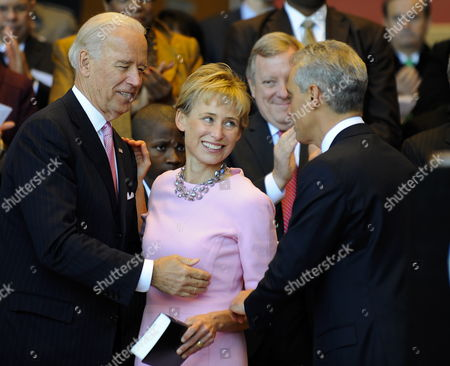 Us Vice President Joseph Biden (l) Stands with Chicago Mayor Rahm Emanuel (r) and His Wife Amy Rule (c) After Emanuel Took the Oath of Office to Become the First Person to Replace Former Mayor Richard M Daley in 22 Years As His Wife Amy Rule (r) Watches at Millennium Park in Chicago Illinois Usa 16 May 2011 Emanuel is a Former Us Congressman and the Former Chief of Staff For President Barack Obama Dailey who Followed in the Footsteps of His Father Former Mayor Richard J Daley Did not Seek Reelection United States Chicago