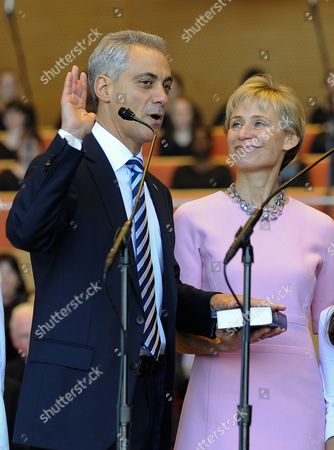 Chicago Mayor Rahm Emanuel (l) Takes the Oath of Office to Become the First Person to Replace Former Mayor Richard M Daley in 22 Years As His Wife Amy Rule (r) Watches at Millennium Park in Chicago Illinois Usa 16 May 2011 Emanuel is a Former Us Congressman and the Former Chief of Staff For President Barack Obama United States Chicago