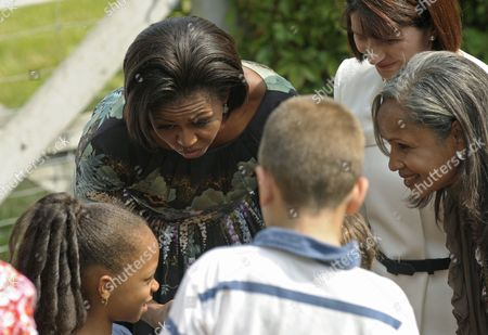 Stock Picture of Us First Lady Michelle Obama (l) with Colombian First Lady Maria Clemencia Rodriguez De Santos (back Right) and Haitian First Lady Elisabeth Preval (front Right) Visit with Local School Children at Stone Barns Center in Westchester New York Usa 24 September 2010 Today's Visit is Part of the First Lady's Healthy Nutrition Program United States Westchester