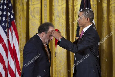 Stock Photo of Us President of the United States Barack Obama Awards the 2010 National Medal of Arts and National Humanities Medal to Roberto Gonzalez Echevarria Among 19 Other Honorees in the East Room in Washington Dc Usa on 02 March 2011 Echevarria Received the Award For His 'Contributions to Spanish and Latin American Literary Criticism His Path-breaking Myth and Archive: a Theory of Latin American Narrative is Among the Most Widely Cited Scholarly Works in Hispanic Literature ' United States Washington