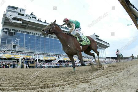 Afleet Alex with Jeremy Rose Smith Onboard Crosses the Finish Line to Win the 130th Running of the Preakness Stakes at Pimlico Race Course in Baltimore Maryland Saturday 21may 2005