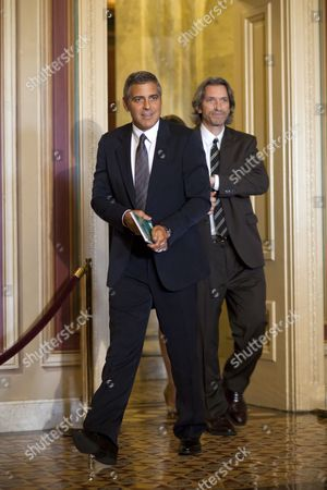 Us Actor and Activist George Clooney (l) Walks with Us Author and Activist John Prendergast (r) Through the Us Capitol to Meet with Republican Senator From Indiana Richard Lugar to Discuss Clooney's Recent Trip to Sudan in Washington Dc Usa on 12 October 2010 Clooney Believes There is a Renewed Chance of Violence in the Country As a January 9 Independence Vote in Southern Sudan Nears United States Washington