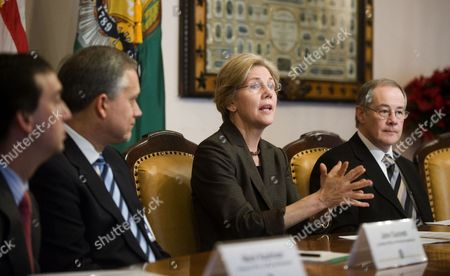 Assistant to the President and Special Advisor to the Secretary of the Treasury on the Cfpb Elizabeth Warren (2-r) with Chairman of Csbs and Banking Commissioner of the State of Iowa Tom Gronstal (r) Delivers Remarks at the Opening of a Roundtable Hosted by the Consumer Financial Protection Bureau (cfpb) Implementation Team at the Us Treasury Department in Washington Dc Usa 04 January 2011 Warren Will This Week Name Holly Petraeus to a Position where She Will Work to Protect Military Families From Predatory Lenders Petraeus is the Wife of General David Petraeus the Us Commander in Afghanistan United States Washington