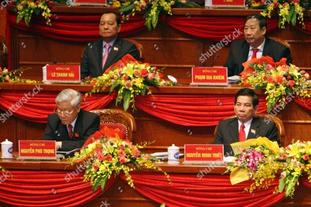 Vietnamese President Nguyen Minh Triet (front R) and National Assembly Chairman Nguyen Phu Trong (front L) Attend the Opening Ceremony of the 12th National Congress of Vietnam's Communist Party (vcp) in Hanoi Vietnam 12 January 2012 the Vcp's 12th Congress Starts From 12 to 19 January 2012 and Will Choose Its New Leadership Viet Nam Hanoi