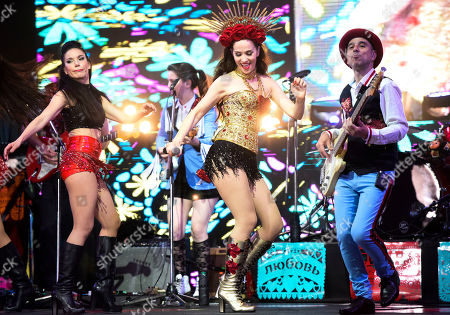 """Uruguayan singer and actress Natalia Oreiro performs in tribute to the late Argentine cumbia singer Gilda, in Montevideo, Uruguay, late . Oreiro starred in the recent film biopic """"No me arrepiento de este amor"""" about Gilda's life and career"""