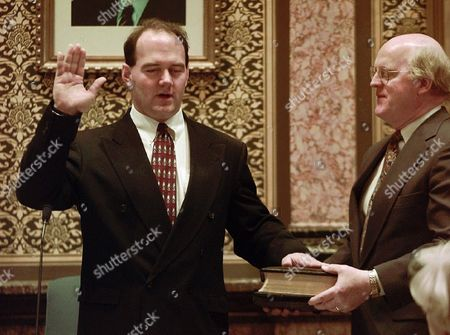 Ron Corbett, Ray Barrett Ron Corbett, R-Linn, is sworn for his second term as Speaker of the House, with the help of Pastor Ray Barrett of Cedar Rapids during the opening of the 1997 Iowa Legislature in Des Moines, Iowa