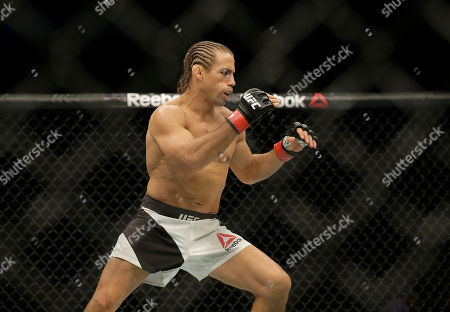 Urijah Faber fights Brad Pickett during a UFC Fight Night mixed martial arts fight in Sacramento, Calif