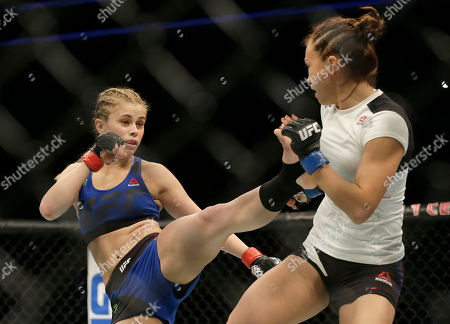 Paige VanZant, left, kicks Michelle Waterson during a UFC Fight Night mixed martial arts fight in Sacramento, Calif