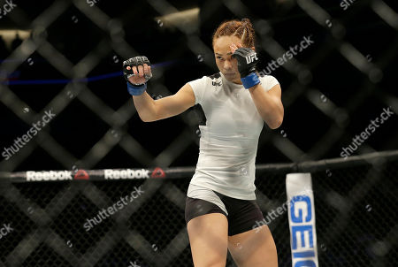 Michelle Waterson stands while fighting Paige VanZant during a UFC Fight Night mixed martial arts fight in Sacramento, Calif