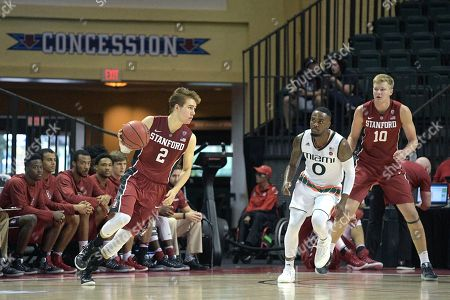 Stanford guard Robert Cartwright (2) controls the ball in front of Miami (Fl) Hurricanes guard Ja'Quan Newton (0) during the second half of an NCAA college basketball game at the AdvoCare Invitational tournament in Lake Buena Vista, Fla., . Miami won 67-53