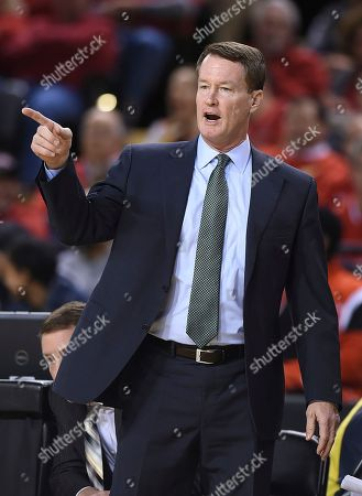 Charlotte coach Mark Price calls to his team during the first half of an NCAA college basketball game against Maryland, in Baltimore. Maryland won 88-72