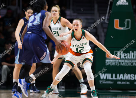 Miami guard/forward Sarah Mortensen (12) defends against Maine guard Tanesha Sutton (23) during the NCAA women's basketball game between the University of Maine Black Bears and the University of Miami Hurricanes at the Watsco Center in Coral Gables, Florida. Miami defeated Maine 76-51